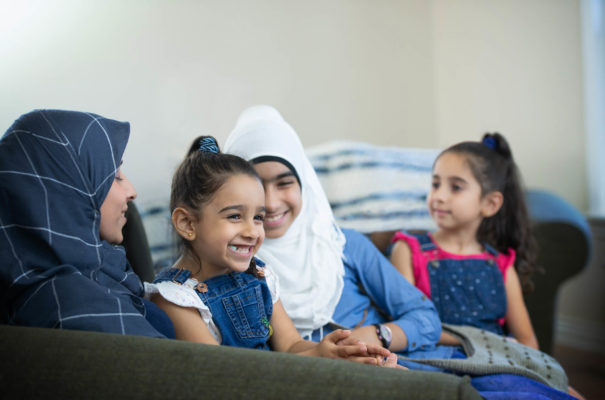 Muslim Family Relaxing on a Sofa stock photo